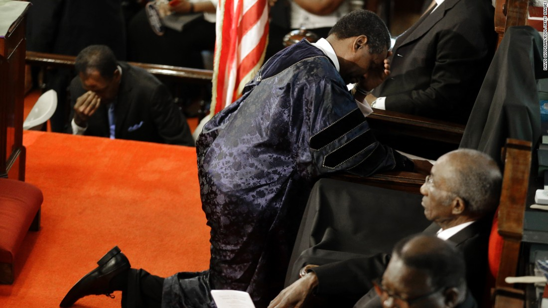 The Rev. Norvel Goff prays at the empty seat of the Rev. Clementa Pinckney, who was killed in the shooting.