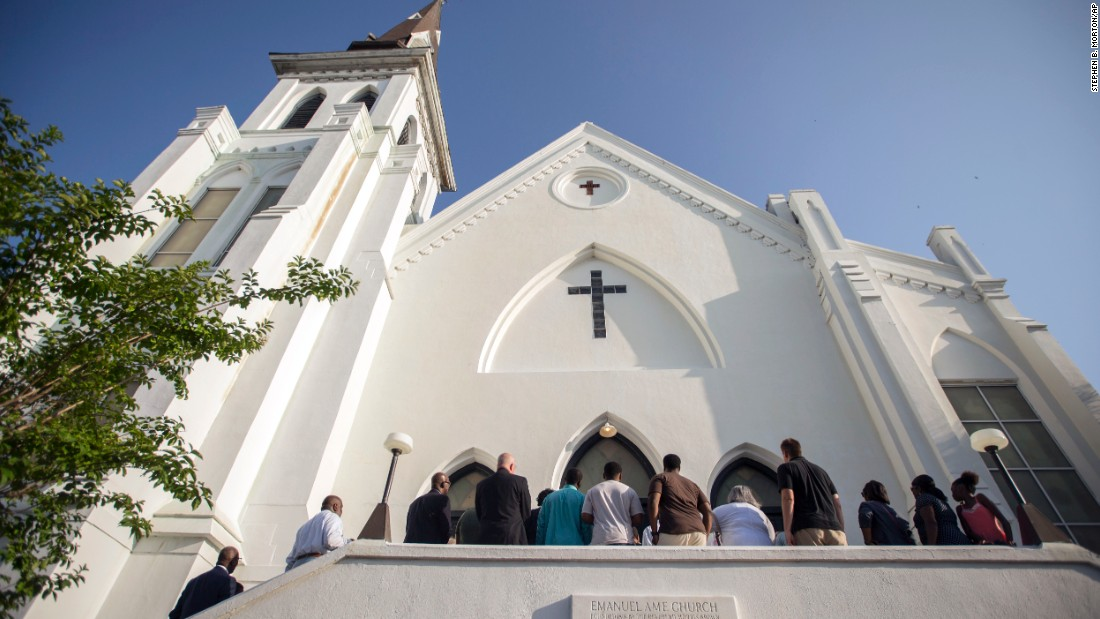 People line up to enter the Emanuel African Methodist Episcopal Church in Charleston, South Carolina, before a worship service on Sunday, June 21. It was the first service at the church since a racially motivated shooter killed nine people there on Wednesday, June 17.