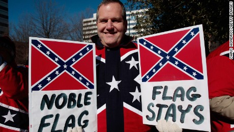 Dr. John Cobin of Greenville, South Carolina holds signs in support of displaying the Confederate flag at a Martin Luther King Day rally January 21, 2008 in Columbia, South Carolina.
