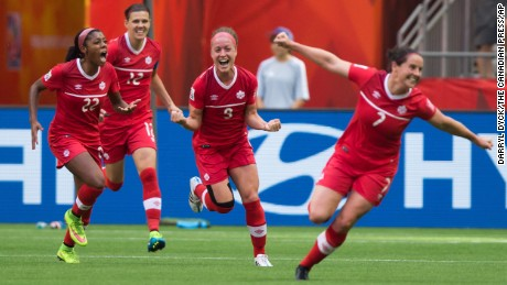 From left, Canada's Ashley Lawrence, Christine Sinclair, Josee Belanger and Rhian Wilkinson celebrate Belanger's goal against Switzerland on Sunday, June 21, in Vancouver. Canada won 1-0.