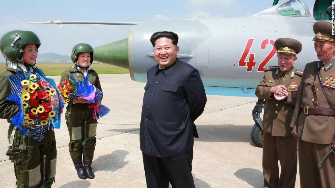 """North Korean leader Kim Jong Un meets with North Korea's first female fighter jet pilots in this undated photo released by the country's state media on Monday, June 22. He called the women """"heroes of Korea"""" and """"flowers of the sky."""""""