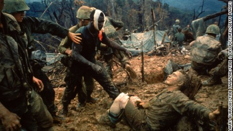 Wounded Marine Gunnery Sgt. Jeremiah Purdie (C) be Caption:VIET NAM - 1966: Wounded Marine Gunnery Sgt. Jeremiah Purdie (C) being led past stricken comrade after fierce firefight for control of Hill 484 south of the DMZ. (Photo by Larry Burrows/Time Magazine/Time & Life Pictures/Getty Images)