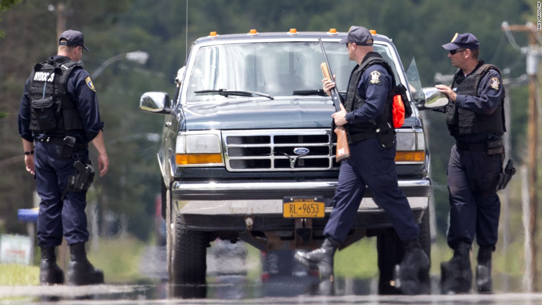 Corrections officers stop a vehicle Monday, June 22, in Owls Head, New York, about 20 to 25 miles west of the prison where convicted killers Richard Matt and David Sweat escaped. The discovery of the escapees' DNA in a cabin has re-energized the 2-week-old search for the fugitives, who staged a movie script-worthy escape from the Clinton Correctional Facility in Dannemora, New York, on June 6.