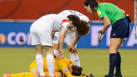 Goalkeeper Kim Jungmi #18 of Korea Republic is hurt on a play during the 2015 FIFA Women#39;s World Cup Round of 16 match against France at Olympic Stadium on June 21, 2015 in Montreal, Quebec, Canada. France defeated Korea Republic 3-0.
