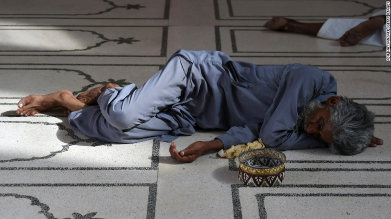 A Pakistani man rests at a mosque during a heat wave in Karachi on June 22.