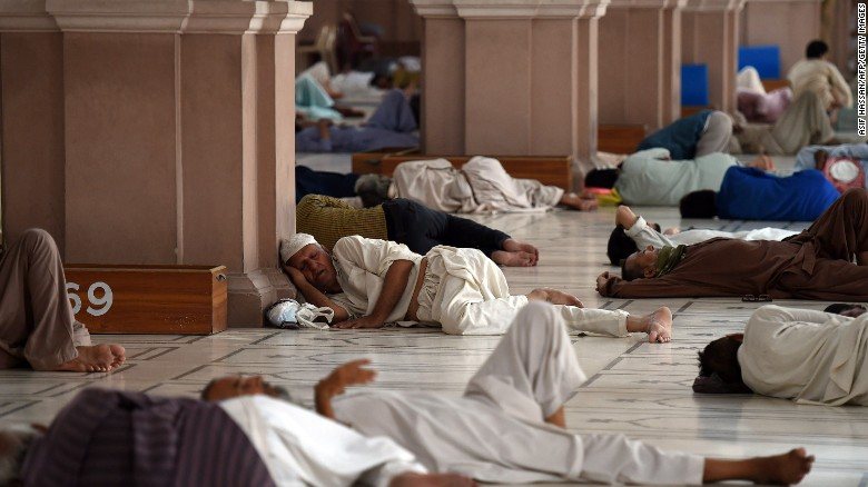 Pakistanis rest at a mosque during a heat wave in Karachi on June 22.