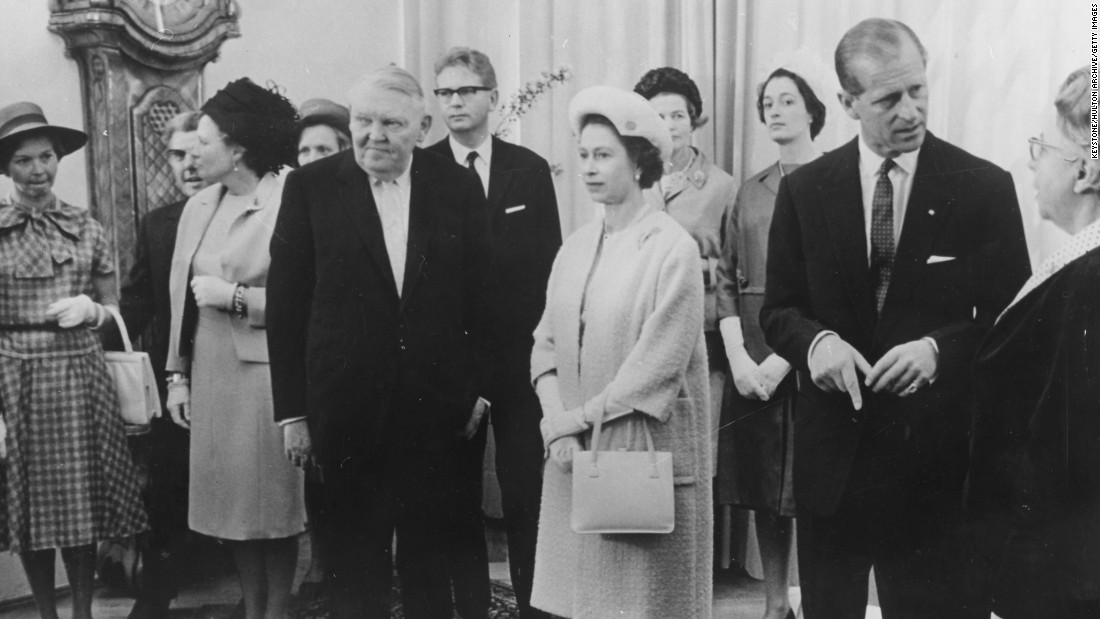 During the Queen's first official visit to Germany, she met with German Chancellor Ludwig Erhard (front left), here attending a luncheon at the Chancellery, Germany, on May 21, 1965.