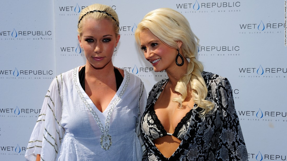 Playboy founder Hugh Hefner's former girlfriends Kendra Wilkinson-Baskett, left, and Holly Madison are arguing over Madison's portrayal of their former life at the Playboy Mansion in her new book.