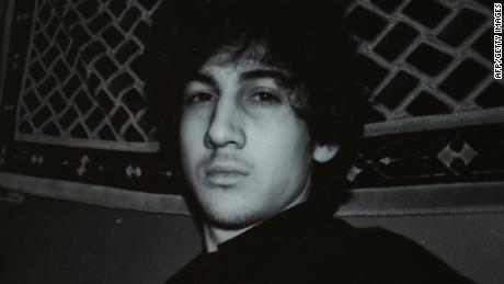 A photo of Dzhokhar Tsarnaev appears on a computer screen from a page off VKontakte, a Russian social media site, in this April 19, 2013 file photo.