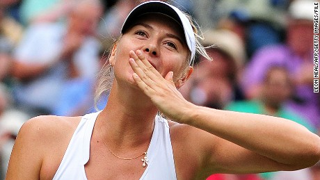 Russian player Maria Sharapova blows a kiss after beating German player Sabine Lisicki during the women's semi final at the Wimbledon Tennis Championships at the All England Tennis Club, in southwest London on June 30, 2011. Sharapova won 6-4, 6-3. AFP PHOTO / LEON NEAL RESTRICTED TO EDITORIAL USE (Photo credit should read LEON NEAL/AFP/Getty Images
