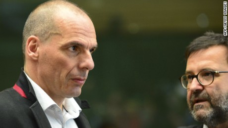 Greek Finance Minister Yanis Varoufakis (L) talks with an advisor before a Eurogroup Council meeting on June 24, 2015 at the EU Headquarters in Brussels. AFP PHOTO / JOHN THYSJOHN THYS/AFP/Getty Images