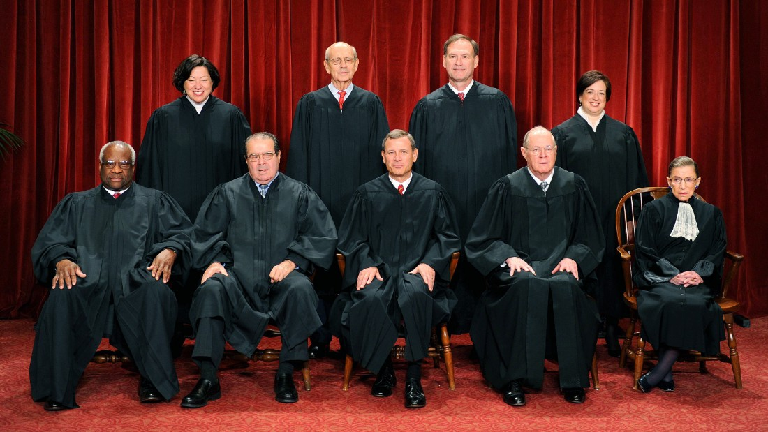 The Justices of the U.S. Supreme Court sit for their official photograph on October 8, 2010, in Washington.