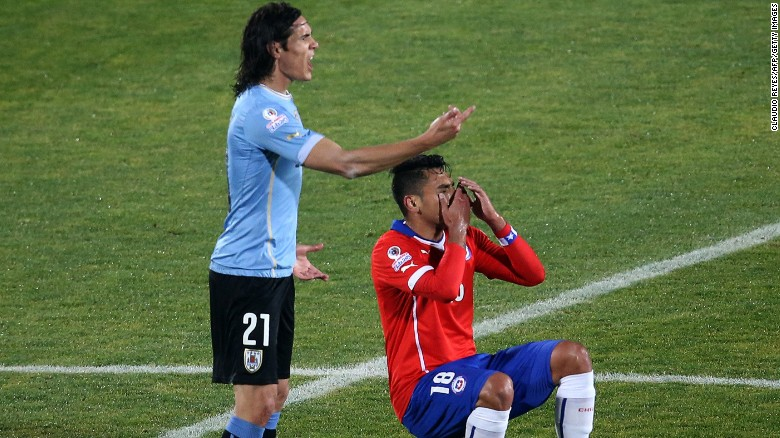 Gonzalo Jara falls to the floor after Edinson Cavani reacts to the Chilean's unwanted attention. The Uruguayan player was sent off after hitting the defender following his unusual action. Chile went on to win the 2015 Copa America quarterfinal 1-0.