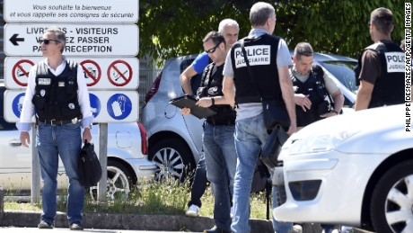 Caption:French police secure the entrance of the Air Products company in Saint-Quentin-Fallavier, near Lyon, central eastern France, on June 26, 2015. An attacker carrying an Islamist flag killed one person and injured several others at a gas factory in eastern France, according to a legal source. The suspected attacker entered the factory and set off several small explosive devices, the source said. A decapitated body was found nearby the factory, another source said. AFP PHOTO/PHILIPPE DESMAZES (Photo credit should read PHILIPPE DESMAZES/AFP/Getty Images)