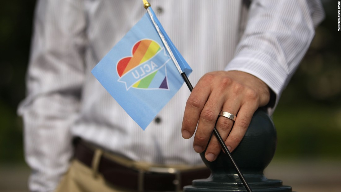 A man holds a rainbow flag outside the Supreme Court on June 26.