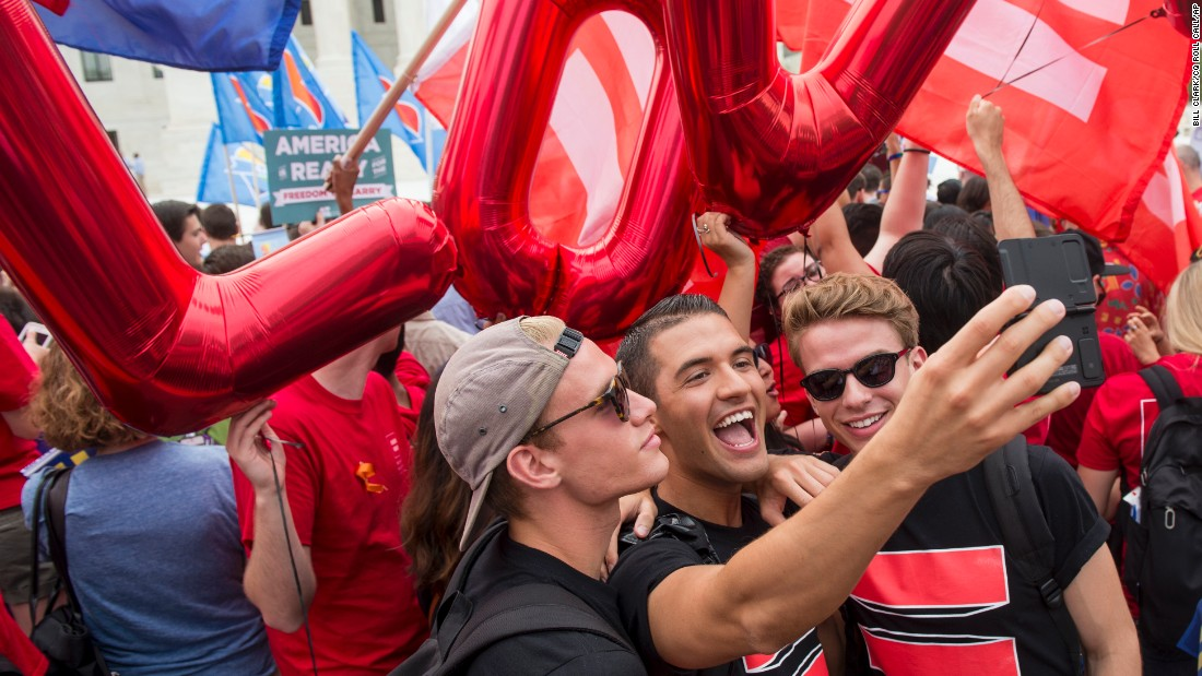 A group of same-sex marriage advocates film a video selfie in front of the Supreme Court on June 26.