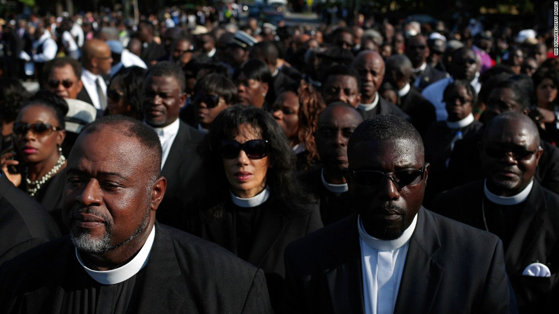 Members of the clergy wait to enter the funeral service.