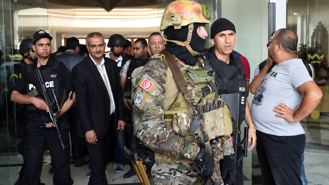 Tunisian security forces stand in front of the Imperial hotel in the resort town of Sousse, a popular tourist destination 140 kilometres (90 miles) south of the Tunisian capital, on June 26, 2015, following a shooting attack. At least 27 people, including foreigners, were killed in a mass shooting at a Tunisian beach resort packed with holidaymakers, in the North African country's worst attack in recent history. AFP PHOTO / FETHI BELAID        (Photo credit should read FETHI BELAID/AFP/Getty Images)