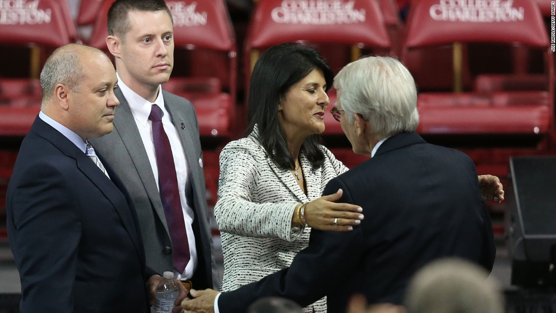 South Carolina Gov. Nikki Haley hugs Charleston Mayor Joseph Riley as they arrive for the funeral.