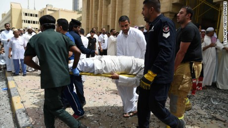 Kuwaiti security personnel and medical staff carry a man on a stretcher at the site of a suicide bombing that targeted the Shiite Al-Imam al-Sadeq mosque after it was targeted by a suicide bombing during Friday prayers on June 26, 2015, in Kuwait City.