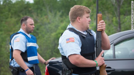 MALONE, NY - JUNE 27: Department of Correction officers man a roadblock on June 27, 2015 in Malone, New York. Escaped convict Richard Matt had recently been shot and killed nearby by law enforcement officers who had been hunting for him and fellow escapee David Sweat. Police have been searching for Matt and Sweat since they were discovered missing from a prison in nearby Dannemora on June 6th.  (Photo by Scott Olson/Getty Images)