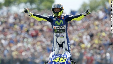 talian MotoGP rider Valentino Rossi of the Movistar Yamaha MotoGP team celebrates after winning the Motorcycling Grand Prix TT Assen at the TT Circuit in Assen on June 27, 2015. AFP PHOTO / ANP / BAS CZERWINSKI ***NETHERLANDS OUT*** (Photo credit should read BAS CZERWINSKI/AFP/Getty Images