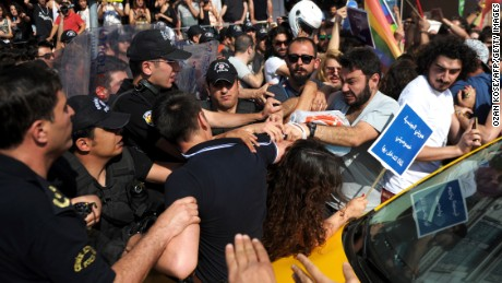 Turkish riot police officers clash with protesters on June 28 ,2015 near the Taksim square in Istanbul. Riot police in Istanbul used teargas and water cannon to disperse thousands of participants of the Gay Pride parade in the Turkish city. Police took action against the crowd when demonstrators began shouting slogans accusing the social conservative President Recep Tayyip Erdogan of 'fascism'. AFP PHOTO/OZAN KOSE (Photo credit should read OZAN KOSE/AFP/Getty Images)