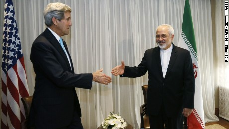 Iranian Foreign Minister Mohammad Javad Zarif (R) shakes hands on January 14, 2015 with US State Secretary John Kerry in Geneva. Zarif said on January 14 that his meeting with his US counterpart was vital for progress on talks on Tehran's contested nuclear drive. Under an interim deal agreed in November 2013, Iran's stock of fissile material has been diluted from 20 percent enriched uranium to five percent, in exchange for limited sanctions relief.