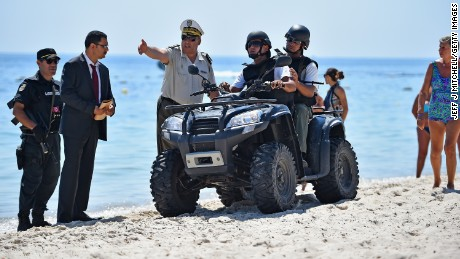 Armed guards patrol Marhaba beach during a visit by British Home Secretary Theresa May at the scene where 38 people were killed on Marhaba beach last Friday, on June 29, Sousse, Tunisia.