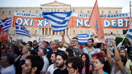 Caption:ATHENS, GREECE - JUNE 29: Demonstrators during a rally in Athens, Greece, 29 June 2015. Greek voters will decide in a referendum next Sunday on whether their government should accept an economic reform package put forth by Greece's creditor. Greece has imposed capital controls with the banks being closed untill the referendum. (Photo by Milos Bicanski/Getty Images)