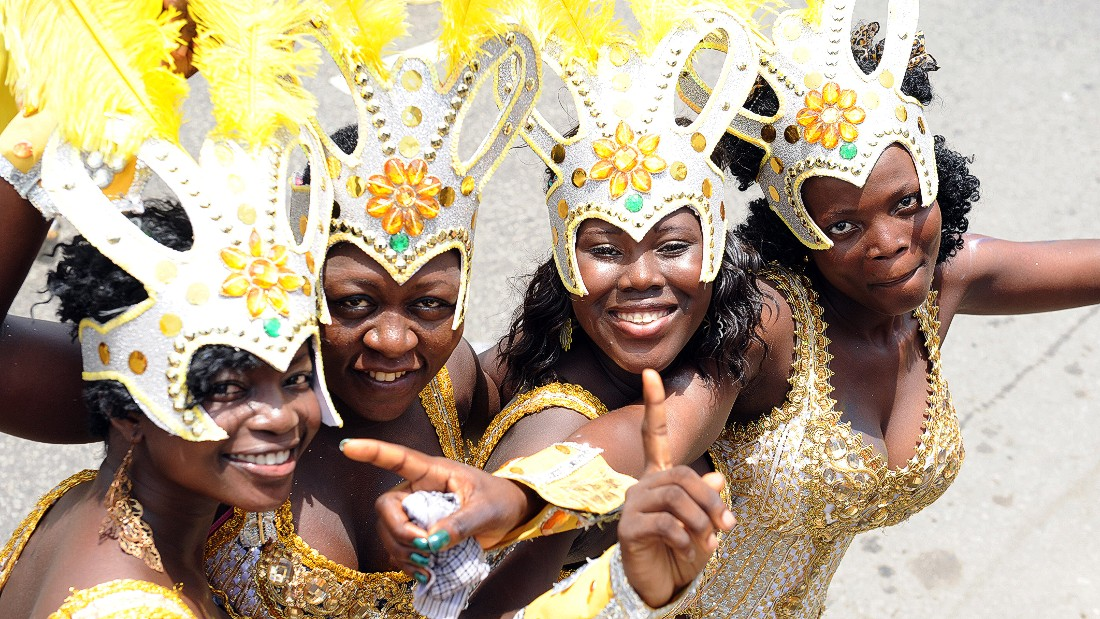Young women pose during Lagos Carnival 2012. How much do their lives differ from their male counterparts?