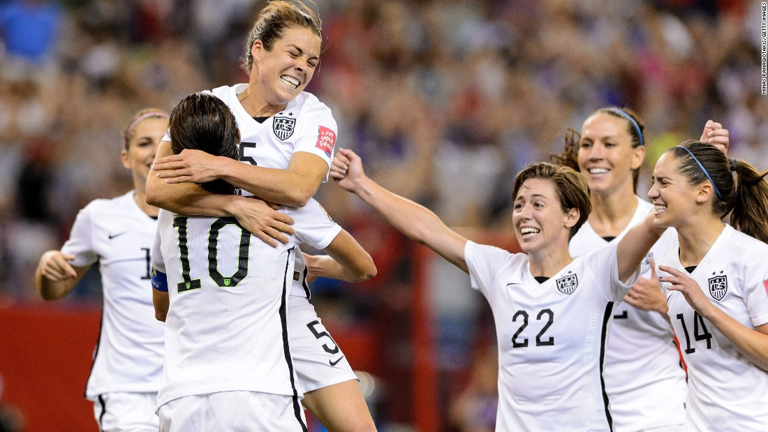 American Kelley O'Hara, top, celebrates with teammates after scoring a goal against Germany on Tuesday, June 30. The goal, late in the second half, clinched a 2-0 semifinal victory for the Americans in Montreal.