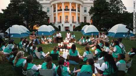 US President Barack Obama and First Lady Michelle Obama talk with Girl Scouts that are camping overnight on the South Lawn of the White House in Washington, DC, June 30, 2015. Fifty Girl Scouts will spend the night on the White House lawn in camping tents as part of the 'Let's Move' campaign to fight childhood obesity and increase nutrition awareness.