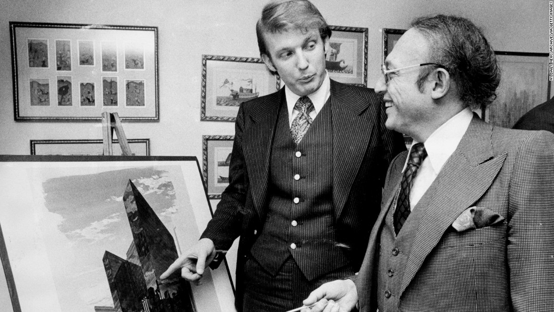 Trump stands with Alfred Eisenpreis, New York's economic development administrator, in 1976 while they look at a sketch of a new 1,400-room renovation project of the Commodore Hotel. After graduating from the University of Pennsylvania in 1968, Trump worked with his father on developments in Queens and Brooklyn before purchasing or building multiple properties in New York and Atlantic City, New Jersey. Those properties included Trump Tower in New York and Trump Plaza and multiple casinos in Atlantic City.