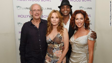 """Left to right, Christopher Lloyd, Lea Thompson, Donald Fullilove and Claudia Wells, cast members in the 1985 film """"Back to the Future,"""" pose together backstage before the """"Back to the Future - In Concert 30th Anniversary"""" event at the Hollywood Bowl on Tuesday, June 30, 2015, in Los Angeles. (Photo by Chris Pizzello/Invision/AP)"""