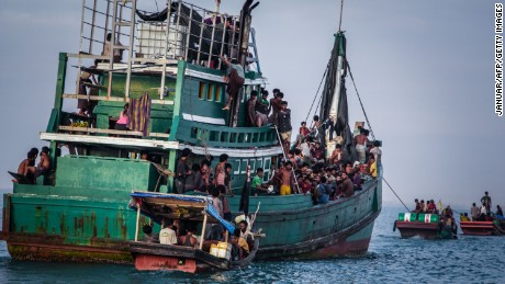 Migrants from Southeast Asia, shown here in May, risk their lives in overloaded boats trying to head for countries like Australia.