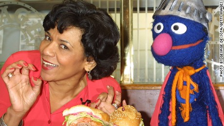 401643 03: Actress Sonia Manzano, who plays Maria Rodriquez on the childrens television show 'Sesame Street,' and the muppet Grover lauch the new 'Super Grover' sandwich in honor of the 4,000th 'Sesame Street' episode February 27, 2002 at the Stage Deli in New York City. (Photo by George De Sota/Getty Images)