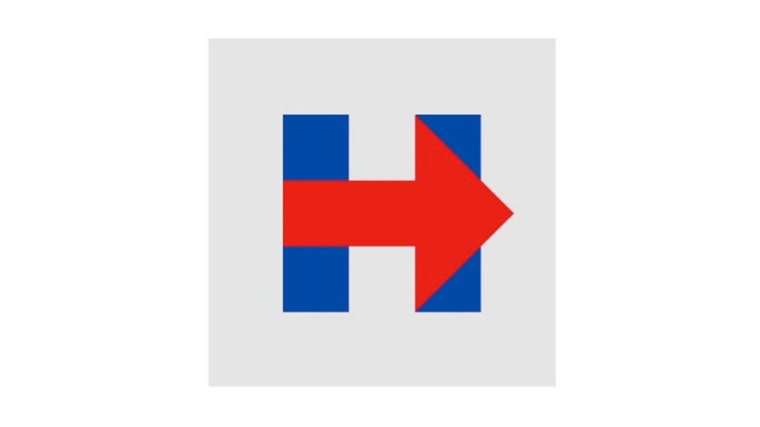 """<em><strong>Hartman</strong></em>: This logo has been the subject of much debate since first debuting. Although I respect and admire the agency that created it, I'm not so certain this conveys the right message. The use of red as the hero color seems odd for the campaign. Another odd choice is that the arrow points right and is over top of the blue. However, what is smart is the campaign walked away from her name as the focus and moved to a symbol. The brand then becomes more versatile and easier to recognize. People will walk away and remember the """"H"""". Whether you like it or not, it's smart. Overall I'd give this a 7/10.<em><br /><strong>Ostrower</em></strong>: I've loved this from the start even when everyone was making fun of it. Hillary has nearly 100% name recognition nationally, so the designers had both the luxury and the obligation to take a bold risk. The result is not only iconic but highly modular: its square orientation makes it optimal for the multitude of social media uses. My favorite use of it is as a window (transparent over an image)<br />"""