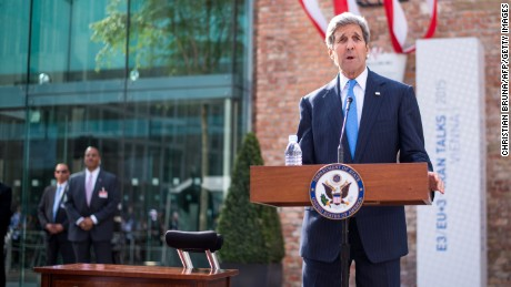 U.S. Secretary of State John Kerry delivers a statement on Cuba outside the hotel where the Iran nuclear talks meetings are being held in Vienna, Austria, July 1, 2015.