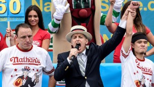 Mike Stonie defeats Joey Chestnut after eating 62 hot dogs at The Nathan's Famous Fourth of July International Hot Dog-Eating Contest in Coney Island, New York, on Saturday, July 4.