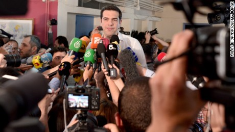 Greek Prime Minister Alexis Tsipras speaks to the press after placing his vote in the austerity referendum at a local school in the suburbs of Athens on July 5, 2015 in Athens, Greece