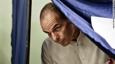 Greek Finance Minister Yanis Varoufakis leaves the voting booth after casting his vote in the referendum at a school in the suburbs of Athens on July 5, 2015 in Athens, Greece.