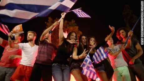 People celebrate in front of the Greek parliament after a referendum on a debt bailout was rejected by voters.