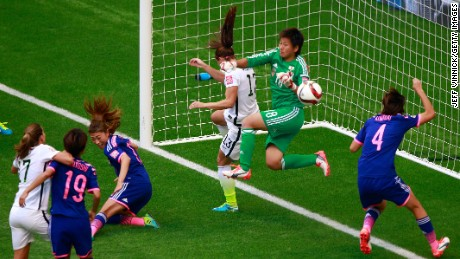 Tobin Heath of the United States, left, scores in the second half of the game.