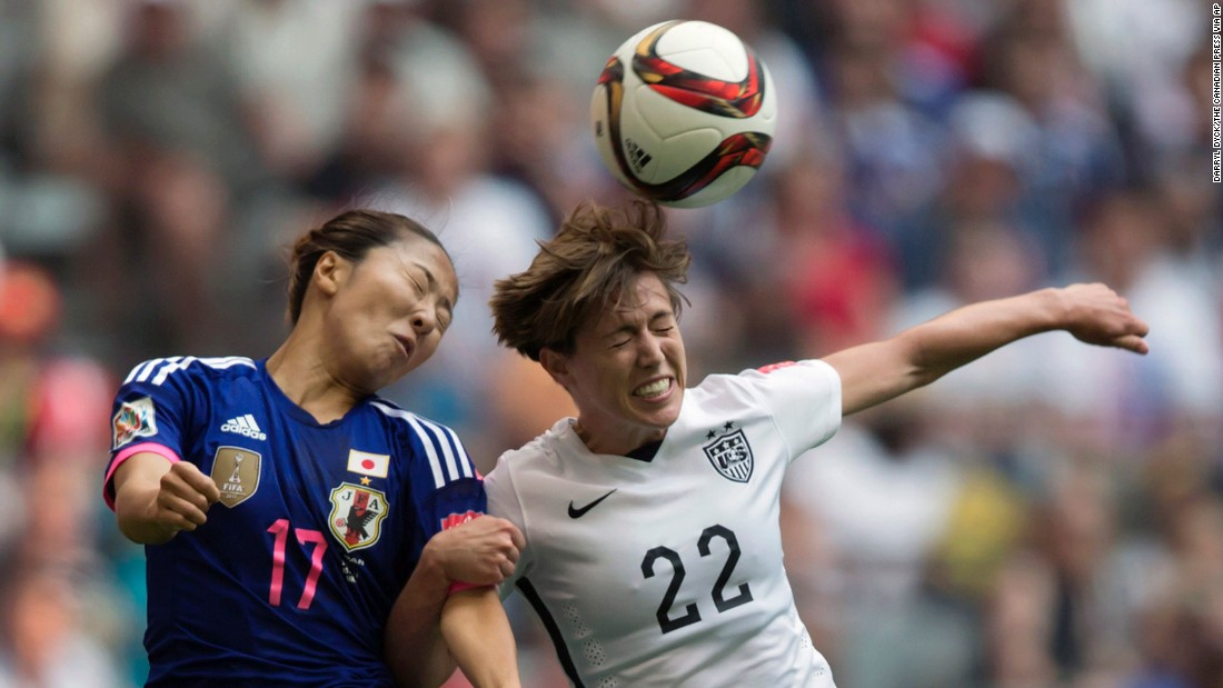 Japan's Yuki Ogimi and United States' Meghan Klingenberg vie for the ball during the second half.