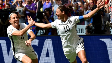Caption:VANCOUVER, BC - JULY 05: Lauren Holiday #12 and Carli Lloyd #10 of the United States celebrate with teammates after Lloyd scores her second goal against Japan in the FIFA Women's World Cup Canada 2015 Final at BC Place Stadium on July 5, 2015 in Vancouver, Canada. (Photo by Rich Lam/Getty Images)