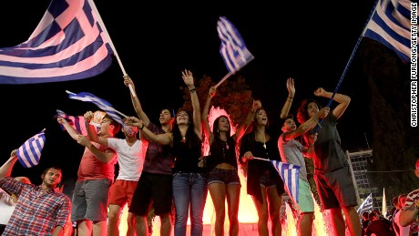 People celebrate in front of the Greek parliament as the people of Greece reject the debt bailout by creditors on July 6, 2015