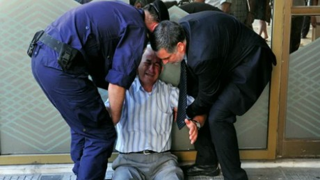 cnnee burke cibercafe man in greece cry because he can not take money from atm_00015522