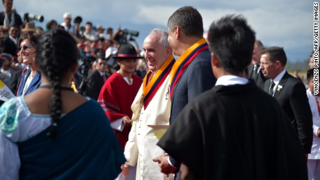 Pope Francis is welcomed by Ecuadorean President Rafael Correa upon his arrival in Quito on Sunday, July 5.