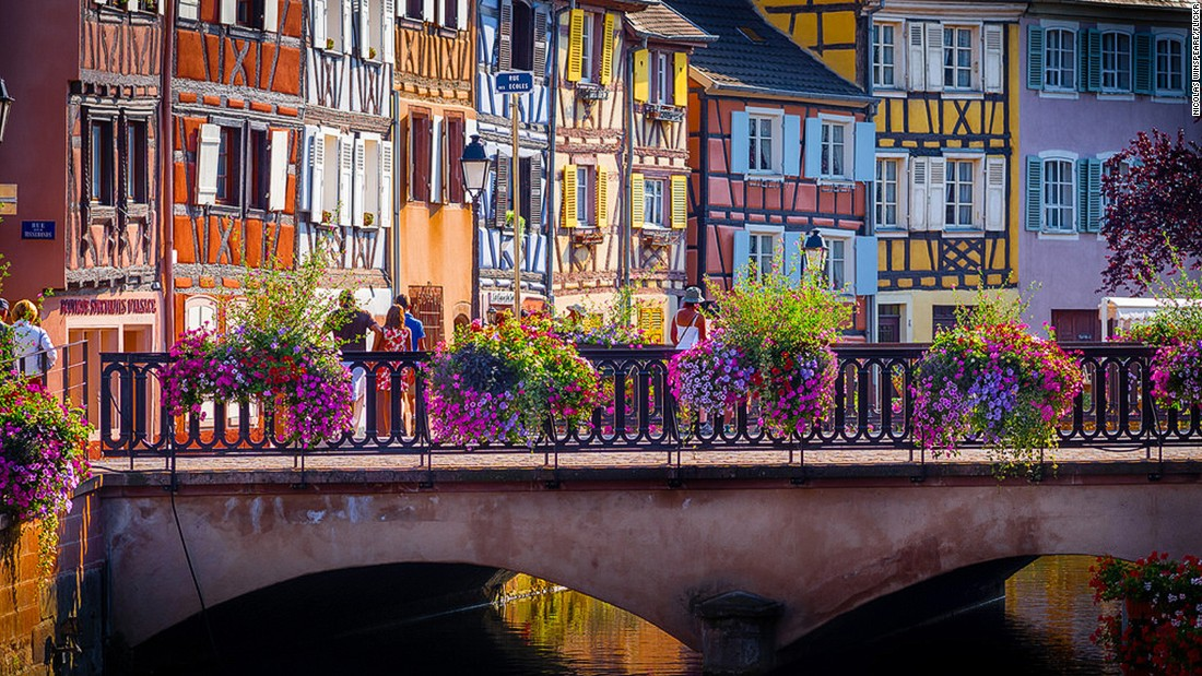 Colmar is a town full of colors. The bright flower-lined canals add to the rows of brightly painted houses. Known as the wine capital of the Alsace region, bordering Germany, Colmar is also the birthplace of Frederic Auguste Bartholdi, the sculptor who designed the Statue of Liberty.
